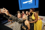 Abby Wambach takes a selfie with Milck, Amena Brown, Jennifer Rudolph Walsh, Glennon Doyle, Cameron Esposito, Nkosi Mabaso, and Nadia Bolz-Weber on stage at Together Live Houston at Lillie & Roy Cullen Theatre on October 17, 2019 in Houston, Texas.