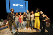 (L-R) Nadia Bolz-Weber, Nkosi Mabaso, Cameron Esposito, Glennon Doyle, Abby Wambach, Jennifer Rudolph Walsh, Amena Brown, and Milck pose for a photo on stage at Together Live Houston at Lillie & Roy Cullen Theatre on October 17, 2019 in Houston, Texas.