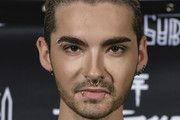 Bill Kaulitz attends the Tokio Hotel Press Conference & Photocall on October 2, 2014 in Berlin, Germany. After a five year break, the new Tokio Hotel record 'Kings Of Suburbia' will be released on October 3.