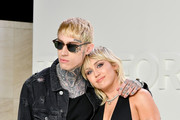 (L-R) Trace Cyrus and Miley Cyrus attend the Tom Ford AW20 Show at Milk Studios on February 07, 2020 in Hollywood, California.