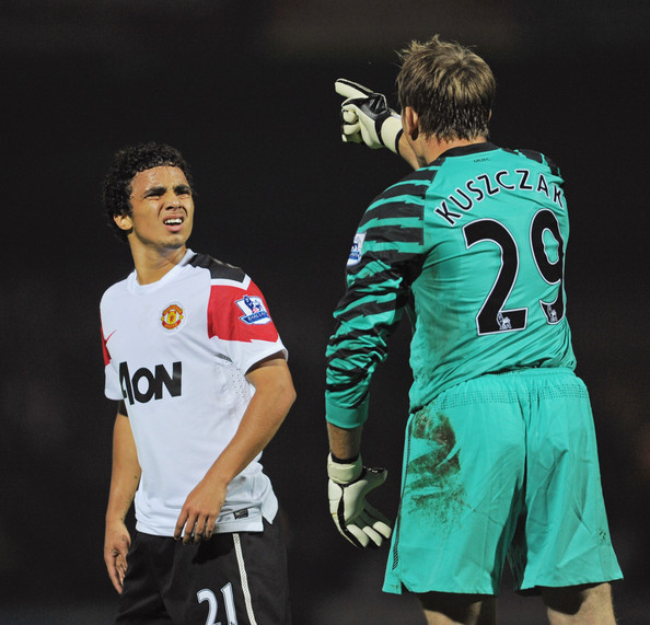 Tomasz Kuszczak Tomasz Kuszczak of Manchester United argues with team mate Rafael after conceding the first goal during the Carling Cup 3rd Round match between Scunthorpe United and Manchester United at Glanford Park on September 22, 2010 in Scunthorpe, England.
