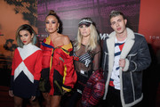 (L-R) Manoela (Manu) Gavassi, Sabrina Sato,Julia Faria and Leo Picon attends the Tommy Hilfiger Drive Now show during Milan Fashion Week Fall/Winter 2018/19 on February 25, 2018 in Milan, Italy.