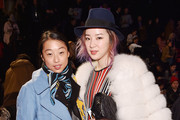 Margaret Zhang and Irene Kim attend Tommy Hilfiger Presents Fall 2015 Women's Collection during Mercedes-Benz Fashion Week Fall 2015 at Park Avenue Armory on February 16, 2015 in New York City.