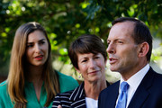 Opposition Leader Tony Abbott speaks to the media as daughter Frances and wife Margie look on at Bear Cottage in Sydney on September 1, 2013 in Sydney, Australia. Australian voters will head to the polls on September 7 to elect the 44th parliament.