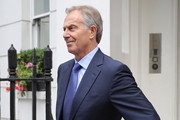 Former British Prime Minister and former Leader of the opposition Labour Party, Tony Blair (right) leaves his Grosvenor Square offices on July 5, 2016 in London, England.  Tomorrow, after many delays, Sir John Chilcot publishes his report into the UK government's involvement in the 2003 Iraq War under the leadership of Tony Blair. The Iraq Inquiry was set up by then Prime Minister Gordon Brown and is published more than seven years after the Inquiry was announced.