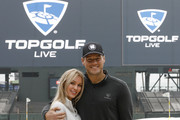 Colton Underwood (R) and Cassie Randolph join thousands in Topgolf's Guinness Book World Record attempt for most golf balls hit simultaneously at Oracle Park in San Francisco, California and all Topgolf venues around the world on November 7, 2019.