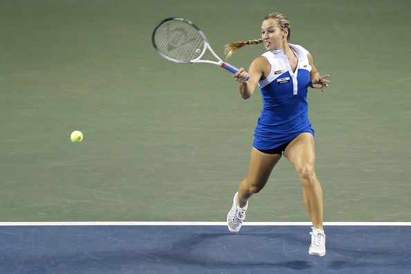 Dominika Cibulkova of Slovakia plays a forehand in her first round match against Anabel Medina Garrigues of Spain during day one of the Toray Pan Pacific Open at Ariake Colosseum on September 23, 2012 in Tokyo, Japan.