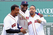 David Ortiz #34 of the Boston Red Sox laughs with Manny Ramirez and Pedro Martinez after the pregame ceremony to honor Ortiz's retirement before his last regular season home game at Fenway Park on October 2, 2016 in Boston, Massachusetts.