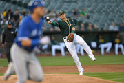 Ryon Healy #25 of the Oakland Athletics makes an off balance throw to first base to throw out Troy Tulowitzki #2 of the Toronto Blue Jays in the top of the second inning at Oakland Alameda Coliseum on June 6, 2017 in Oakland, California.