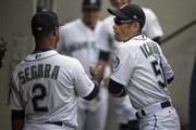 Ichiro Suzuki #51 of the Seattle Mariners jokes around in the dugout with Jean Segura #2 of the Seattle Mariners before a game against the Toronto Blue Jays at Safeco Field on August 2, 2018 in Seattle, Washington. The Blue Jays won 7-3.