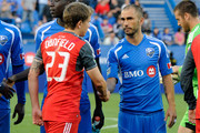 Marco Di Vaio #9 of the Montreal Impact shakes hands with Terry Dunfield #23 of the Toronto FC at the Saputo Stadium on June 27, 2012 in Montreal, Quebec, Canada.  The Toronto FC defeated the Impact 3-0.
