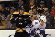 Gregory Campbell #11 of the Boston Bruins hits Joey Crabb #46 of the Toronto Maple Leafs at the TD Garden on March 19, 2012 in Boston, Massachusetts. The Bruins defeated the Maple Leafs 8-0.