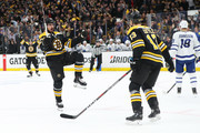 Marcus Johansson #90 of the Boston Bruins celebrates with Charlie Coyle #13 after scoring a goal against the Toronto Maple Leafs during the first period Game Seven of the Eastern Conference First Round during the 2019 NHL Stanley Cup Playoffs at TD Garden on April 23, 2019 in Boston, Massachusetts.
