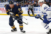 Zemgus Girgensons #28 of the Buffalo Sabres and Tyler Bozak #42 of the Toronto Maple Leafs at the faceoff circle during the second period at KeyBank Center on March 5, 2018 in Buffalo, New York.