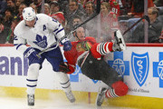 Connor Murphy #5 of the Chicago Blackhawks hits the wall after chasing the puck with Patrick Marleau #12 of the Toronto Maple Leafs at the United Center on January 24, 2018 in Chicago, Illinois.
