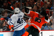 Scott Hartnell #19 of the Philadelphia Flyers is checked by Joey Crabb #46 of the Toronto Maple Leafs in the second period of an NHL hockey game at Wells Fargo Center on February 9, 2012 in Philadelphia, Pennsylvania.