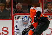 Joey Crabb #17 of the Philadelphia Flyers is stopped by goalie James Reimer #34 of the Toronto Maple Leafs in the first period of an NHL hockey game at Wells Fargo Center on February 9, 2012 in Philadelphia, Pennsylvania.