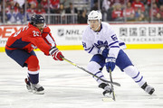 Jake Gardiner #51 of the Toronto Maple Leafs skates past Devante Smith-Pelly #25 of the Washington Capitals during the first period at Capital One Arena on October 13, 2018 in Washington, DC.