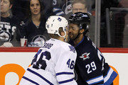 Johnny Oduya #29 of the Winnipeg Jets and Joey Crabb #46 of the Toronto Maple Leafs go head to head before they fight in NHL action at the MTS Centre on February 7, 2012 in Winnipeg, Manitoba, Canada.