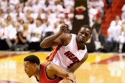 Kyle Lowry #7 of the Toronto Raptors drives past Luol Deng #9 of the Miami Heat during Game 6 of the Eastern Conference Semifinals of the 2016 NBA Playoffs at American Airlines Arena on May 13, 2016 in Miami, Florida. NOTE TO USER: User expressly acknowledges and agrees that, by downloading and or using this photograph, User is consenting to the terms and conditions of the Getty Images License Agreement.
