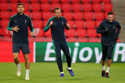 (L-R) Fernando Llorente, Harry Kane and Hugo Lloris of Tottenham Hotspur warm up during a training session ahead of their UEFA Champions League Group B match against PSV at Philips Stadion on October 23, 2018 in Eindhoven, Netherlands.