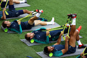 (L-R) Christian Eriksen, Harry Kane and Mousa Dembele of Tottenham Hotspur stretch during the Tottenham Hotspur training session at San Siro Stadium on September 17, 2018 in Milan, Italy.