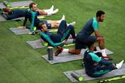 (L-R) Lucas Moura, Christian Eriksen, Harry Kane, Mousa Dembele and Danny Rose of Tottenham Hotspur stretch during the Tottenham Hotspur training session at San Siro Stadium on September 17, 2018 in Milan, Italy.