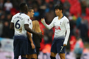 Son Heung-min of Tottenham Hotspur with Davinson Sanchez and Harry Winks of Tottenham Hotspur after the Premier League match between Tottenham Hotspur and Cardiff City at Wembley Stadium on October 6, 2018 in London, United Kingdom.