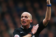 Referee Mike Dean signals during the Barclays Premier League match between Tottenham Hotspur and Manchester United at White Hart Lane on April 10, 2016 in London, England.