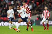 Mousa Dembele of Tottenham Hotspur and Darren Fletcher of Stoke City during the Premier League match between Tottenham Hotspur and Stoke City at Wembley Stadium on December 9, 2017 in London, England.
