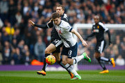 Ben Davies of Tottenham Hotspur and Almen Abdi of Watford compete for the ball during the Barclays Premier League match between Tottenham Hotspur and Watford at White Hart Lane on February 6, 2016 in London, England.