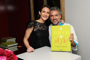 Zani Gugelmann and Carlos Mota attend the A Touch Of Style Book Signing with Carlos Mota at the D&D Building Assouline Showroom on April 14, 2015 in New York City.