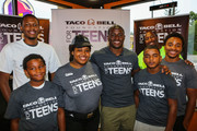 Detroit Lions running back Reggie Bush (C) and Boy & Girls Club of America members attend the Touchdown For Teens Campaign at Taco Bell on August 26, 2014 in Royal Oak, Michigan.