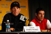 Lance Armstrong of Team Radio Shack speaks as George Hincapie of BMC Racing listens during a during a press conference prior to the 2010 Tour of California at the Sacramento Convention Center on May 14, 2010 in Sacramento, California.