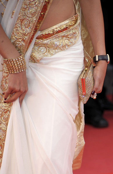 Actress Deepika Padukone (handbag and dress detail) attends the 'On Tour' Premiere at the Palais des Festivals during the 63rd Annual Cannes Film Festival on May 13, 2010 in Cannes, France.