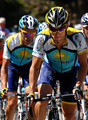 Lance Armstrong (R) of the USA and team Astana climbs flanked by his teammate Alberto Contador (L) of Spain up the Col d'Agnes during stage eight of the 2009 Tour de France from Andorra la Vella to St Girons on July 11, 2009 on Col d'Agnes, France.