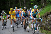 Race leader Alberto Contador (L) of Spain and team Astana climbs in the yellow jersey with his teammates Lance Armstrong (2nd R) of USA and Sergio Paulinho (R) of Portugal and team Garmin - Slipstream rider Bradley Wiggins (2nd L) of Great Britain up the Col du Petit-Saint-Bernard during stage 16 of the 2009 Tour de France from Martigny to Bourg-Saint-Maurice on July 21, 2009 on Col du Petit-Saint-Bernard, Italy.