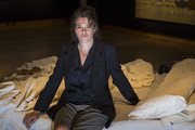 Tracy Emin sits on her 1998 piece 'My Bed' on display at Christie's on June 27, 2014 in London, England. This iconic work from the YBA moment is being offered at auction for the first time and is estimated to sell for between 800,000 - 1.2 million GBP.