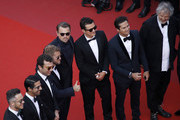 """Andre Lotterer, Sam Bird, Leonardo DiCaprio, Orlando Bloom, Nelson Piquet Jr. and Malcolm Venville attend the screening of """"The Traitor"""" during the 72nd annual Cannes Film Festival on May 23, 2019 in Cannes, France."""