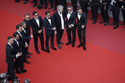 """Andre Lotterer, Sam Bird, Leonardo DiCaprio, Orlando Bloom, Nelson Piquet Jr., Malcolm Venville, Alejandro Agag and Jean-Eric Vergne attend the screening of """"The Traitor"""" during the 72nd annual Cannes Film Festival on May 23, 2019 in Cannes, France."""