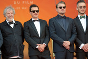 """(L-R) Malcolm Venville, Orlando Bloom, Leonardo DiCaprio and Andre Lotterer attend the screening of """"The Traitor"""" during the 72nd annual Cannes Film Festival on May 23, 2019 in Cannes, France."""