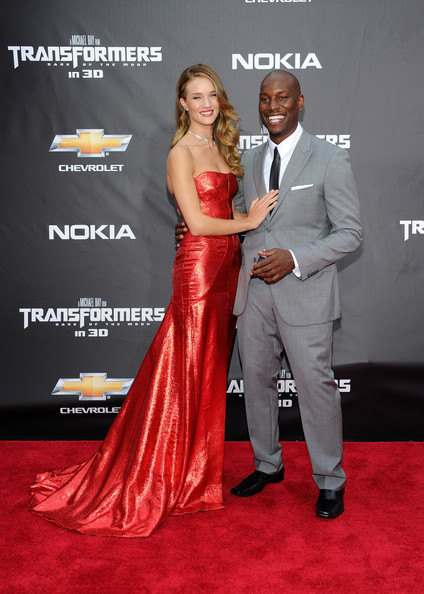 "Rosie Huntington-Whiteley (L) and Tyrese Gibson attend the New York premiere of ""Transformers: Dark Side Of The Moon"" in Times Square on June 28, 2011 in New York City."