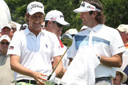 Webb Simpson and Bubba Watson chat on the 1st tee box during Round One of the 2012 Travelers Championship at TPC River Highlands on June 21, 2012 in Cromwell, Connecticut.