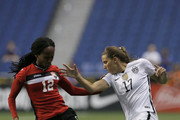 Tobin Heath #17 of the United States battles for the ball with Ahkeela Mollon #12 of Trinidad & Tobago during an international friendly match at the Alamodome on December 10, 2015 in San Antonio, Texas.