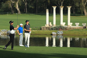 Nacho Elvira of Spain takes his third shot on the 12th hole as Brett Rumford of Australia and Chris Wood of England looks on during Day One of the Trophee Hassan II at Royal Golf Dar Es Salam on April 19, 2018 in Rabat, Morocco.
