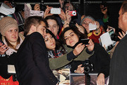 Robert Pattinson greets fans as he attends the UK Premiere of 'The Twilight Saga: Breaking Dawn - Part 2' at Odeon Leicester Square on November 14, 2012 in London, England.