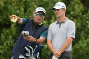 Justin Rose of England talks with his caddie Mark Fulcher on the 15th tee during the second round of the 2018 U.S. Open at Shinnecock Hills Golf Club on June 15, 2018 in Southampton, New York.
