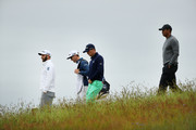 (L-R) Dustin Johnson of the United States, caddie Jimmy Johnson, Justin Thomas of the United States, and Tiger Woods of the United States walk the 13th fiarway during the second round of the 2018 U.S. Open at Shinnecock Hills Golf Club on June 15, 2018 in Southampton, New York.