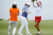 Inbee Park of South Korea is doused with champagne by Na Yeon Choi and So Yeon Ryu of South Korea after winning the 2013 U.S. Women's Open at Sebonack Golf Club on June 30, 2013 in Southampton, New York.