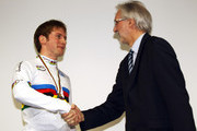 British Cycling President Brian Cookson (R) presents Jason Kenny of Great Britain with the Sprint World Champion's Rainbow jersey on day one of the UCI Track Cycling World Cup - LOCOG Test Event for London 2012 at the 2012 Olympic Velodrome on February 16, 2012 in London, England. Race winner Gregory Bauge was stripped of his medal after missing a drug test. As a result, Jason Kenny has moved up from his individual sprint silver medal position to gold, with Chris Hoy niow taking silver over his original bronze position.